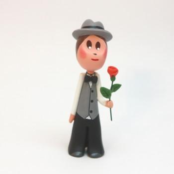Homme borsalino et sa rose